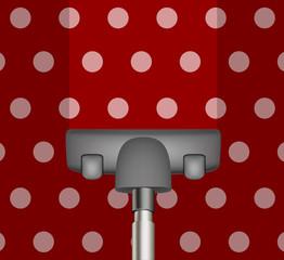 Vacuum cleaner drains red carpet