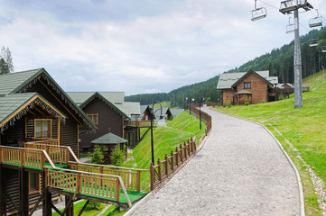 cottages, chair lift in Carpathian Mountains