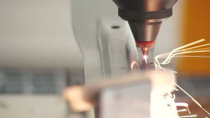 metal laser cutting detail using the robotic arm