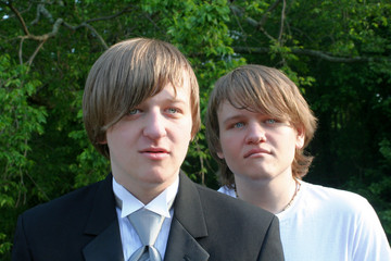 Serious Brothers In Tux And T-Shirt