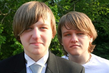 Teen Brothers In Tux And T-Shirt