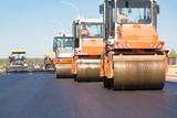 Road rollers machines compacting fresh asphalt