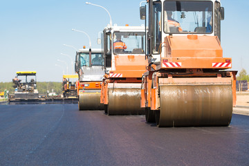 Road rollers machines compacting fresh asphalt