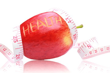Red apple ,health text and measuring tape wrapped around ,on iso
