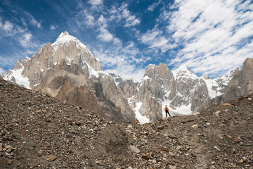 Trekker with Karakoram mountain range, Northern Pakistan