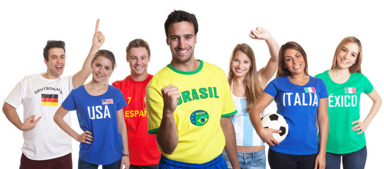 Laughing sports fan from Brazil with fans from other countries
