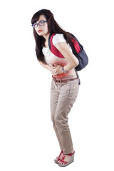 Female student having abdominal pain