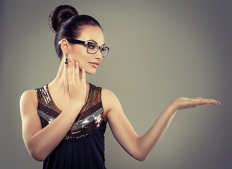 Pretty female model in stylish eyeglasses with retro hairdo