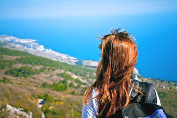 portrait of a young girl enjoying a tourist on a hill overlookin