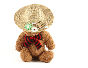 Brown teddy bear with summer hat