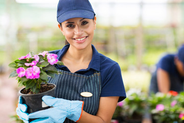 young female gardener holding flowers