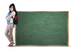 Student standing next to chalkboard 1