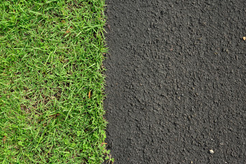New asphalt road surface and green grass, background