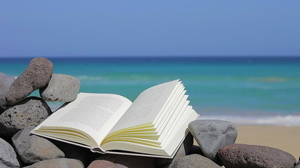 Book on the beach. Relax concept