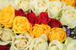 Yellow, white and red roses in a wedding arrangement