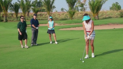 Happy friends playing in golf club, sport, leisure, fun, hobby