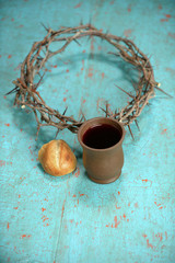Bread, wine and Crown of Thorns on Table