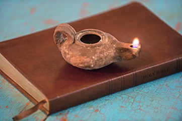Ancient Lamp on Bible