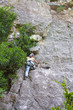 Female climber on a cliff