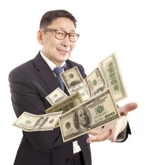 Businessman throwing dollar