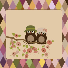 Greeting card with owls on beige background