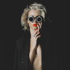 Fashion blonde with bright makeup and accessories