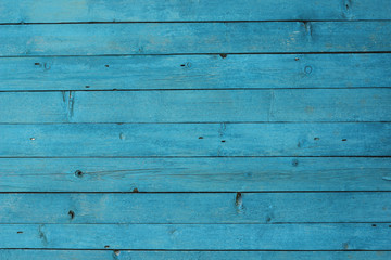 pine boards painted in blue color background