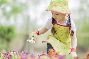 Little girl in the garden
