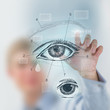 Doctor working virtual interface examining human eye