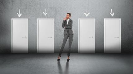 Businesswoman choosing right door