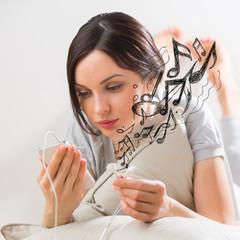 Woman listening music smartphone