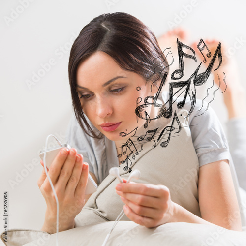 Woman listening music smartphone