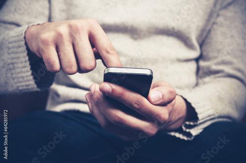 Leinwanddruck Bild Man using smartphone