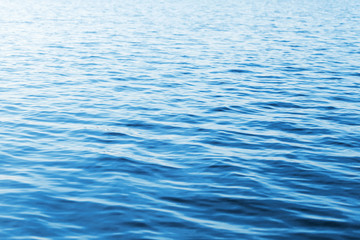 Blue water photo background with soft waves