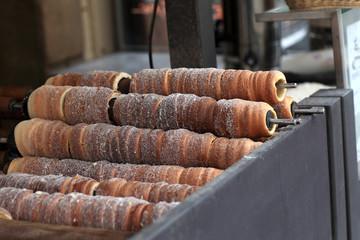 Baking of czech trdelnik