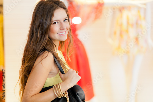 Young woman shopping in a mall and looking at the camera