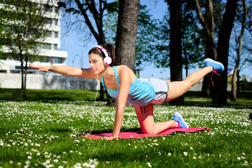 Fitness woman on stretching workout in park