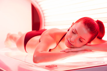 Sunbathing on tanning bed.