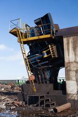 metal press machine on at the scrap metal junkyard