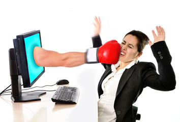 woman with computer hit by boxing glove in work stress