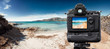 DSLR Camera on tripod shooting in the beach - 64297315