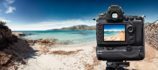 DSLR Camera on tripod shooting in the beach