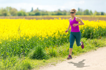 Woman runner happy running jogging on sunny day