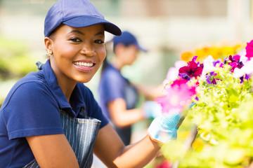 african female florist working in nursery