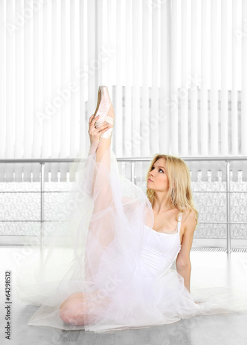 Beautiful balerina dancing in ballet class