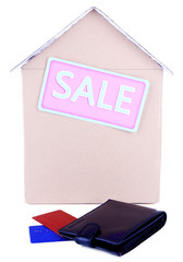 Cardboard house with wallet and credit cards isolated on white