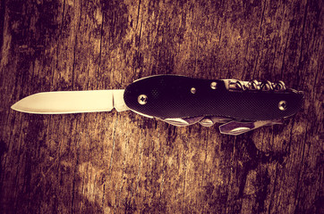 black swiss army knife wood color toned