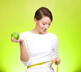 Healthy eating, weight loss. Fit girl on green background
