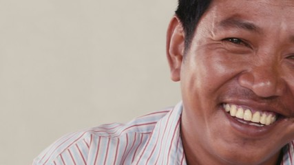 Portrait of Asian man looking at camera, people emotions
