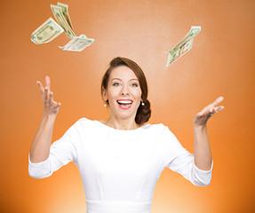 Make it rain. Woman throwing money in air on orange background